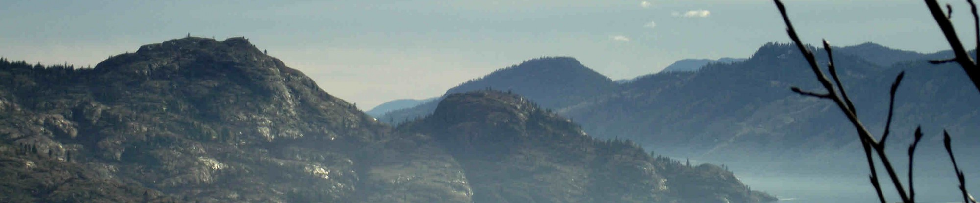 cropped photograph of Okanagan Lake and mountains near Peachland, BC
